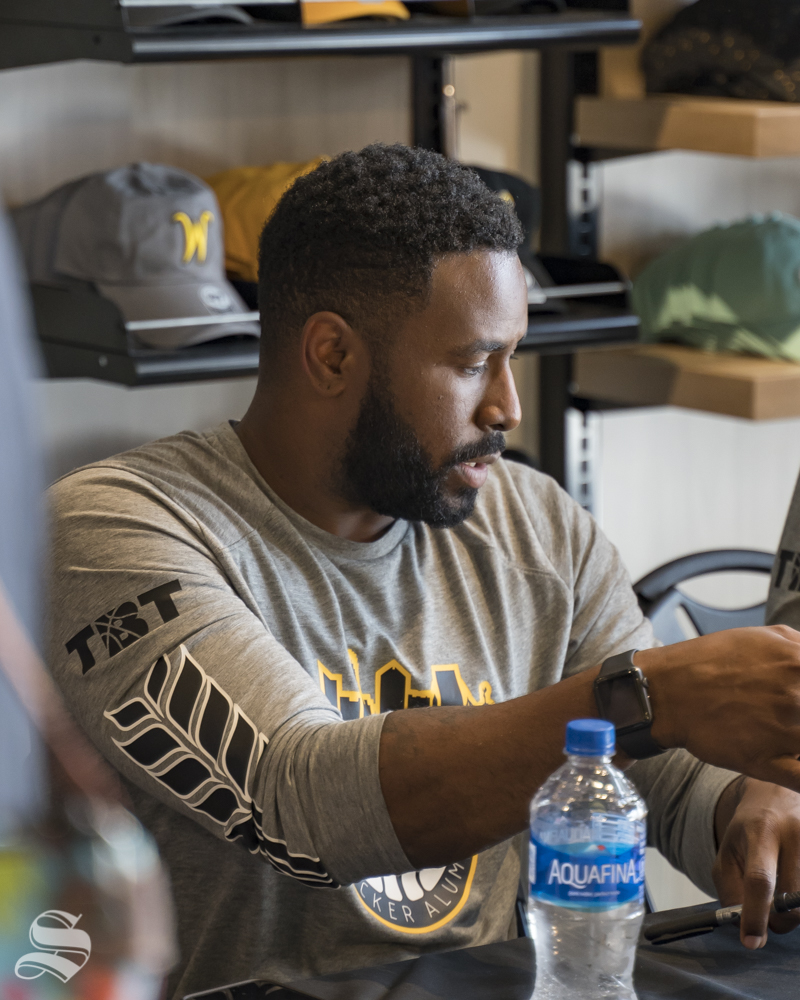 AfterShocks head coach Karon Bradley talks to a fan during the autograph signing. The event was held at Shocker Store on July 21st, 2019.