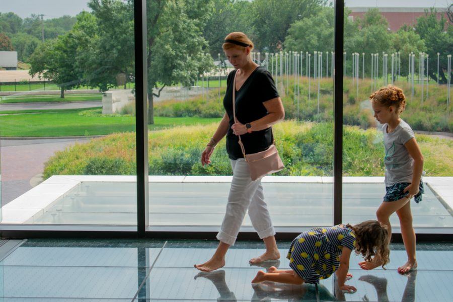 Lisa%2C+Olivia+and+Brielle+Parsons+look+at+the+Chihuly+glass+floor+piece+during+a+free+entry+Saturday+on+August+10+at+the+Wichita+Art+Museum.