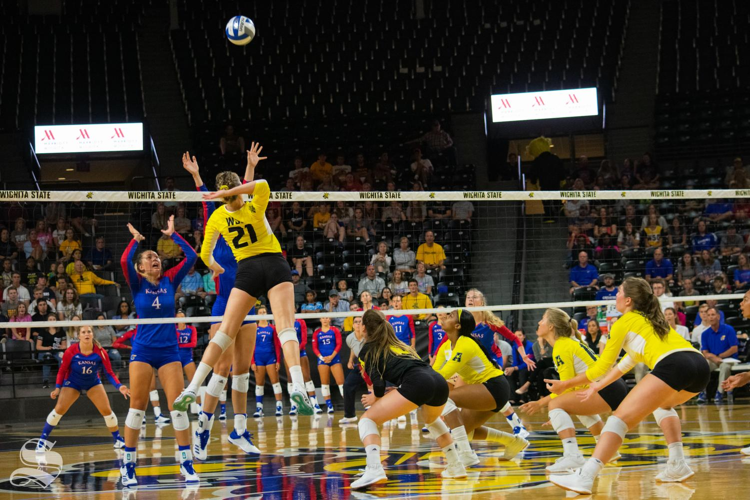 Wichita State sophomore Megan Taflinger goes up for a kill during Saturday's exhibition match against Kansas inside Charles Koch Arena.