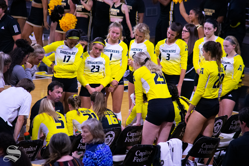 Shocker's head coach Chris Lamb gives instruction to his team during their exhibition against Kansas University on Aug. 17 in Charles Koch Arena.
