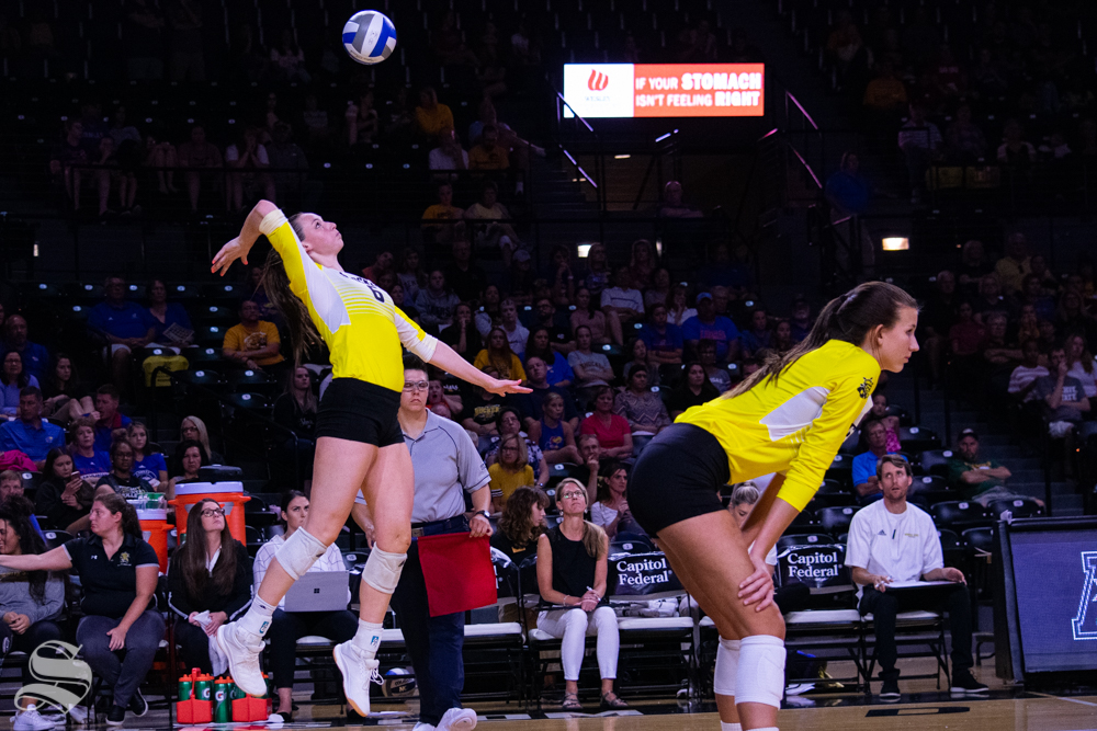 Wichita State's Emma Wright serves the ball during the last set of their exhibition against Kansas on Aug. 17 inside Charles Koch Arena.