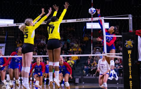 Kansas University's Ashley Smith sends the ball toward Wichita State's Brooke Smith and Damadj Johnson. The exhibition was held on Aug. 17 in Charles Koch Arena.