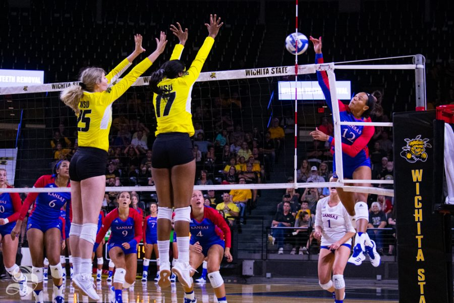 Kansas+University%27s+Ashley+Smith+sends+the+ball+toward+Wichita+State%27s+Brooke+Smith+and+Damadj+Johnson.+The+exhibition+was+held+on+Aug.+17+in+Charles+Koch+Arena.
