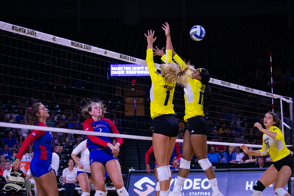 Wichita State's Skylar Goering and Damadj Johnson miss a send by Kansas University's Rachel Langs.