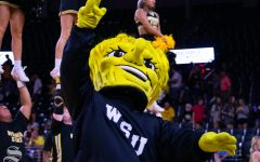 Wu pumps up the crowd during the exhibition against Kansas University on Aug. 17 at Charles Koch Arena. (FILE PHOTO)