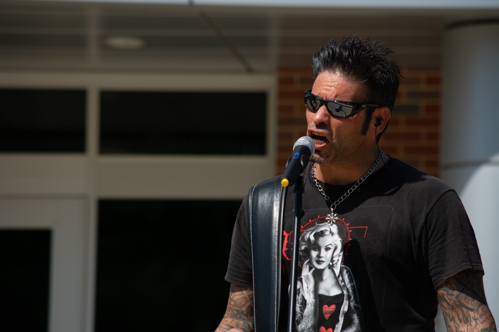 Annie Up's Rick Lopez sings a cover with other band members during the kick-off concert outside of the Rhatigan Student Center on Aug. 19.