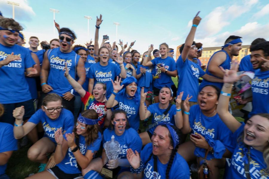 Students+from+the+College+of+Applied+Studies+celebrate+their+win+at+the+Clash+of+the+Colleges+event+on+Aug.+23+at+Cessna+Stadium.
