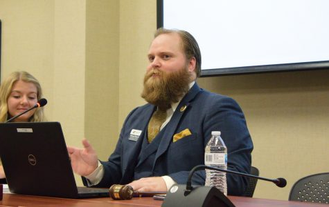 Student Body Vice President Michael Bearth speaks Wednesday at the first SGA meeting of the semester. The student senate heard bids for recognition from four student groups at the meeting.