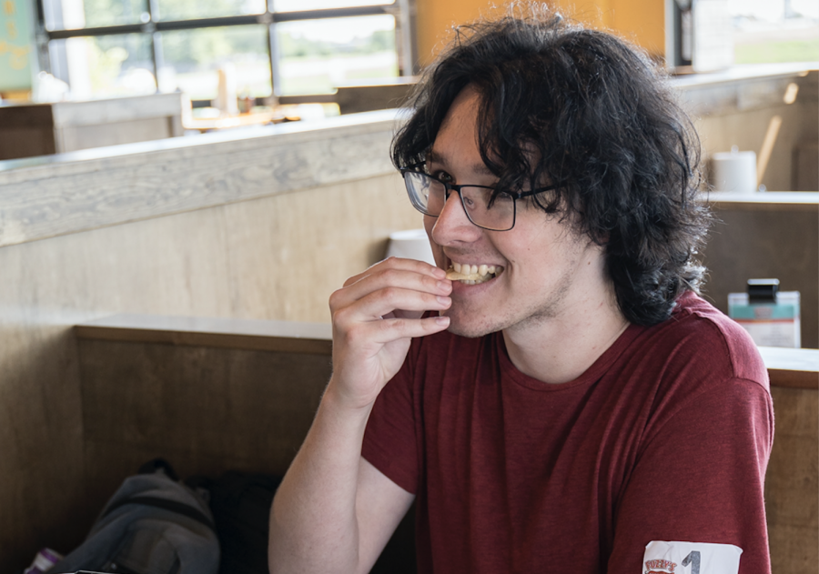Graphic design student Christian Hurst was the first of 50 people to win free tacos for a year from WSU's new Fuzzy's Taco Shop on Innovation Campus. Hurst stood in line from 1 p.m. Sunday until the restaurant opened at 10 a.m. Monday.