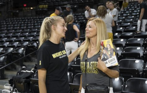 Wichita State freshman Skylar Goering talks to her mother after the exhibition match against Kansas on August 17 inside Charles Koch Arena.