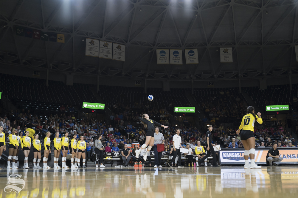 Wichita State senior Kara Bown serves the ball during the exhibition game against KU on August 17 at Koch Arena.