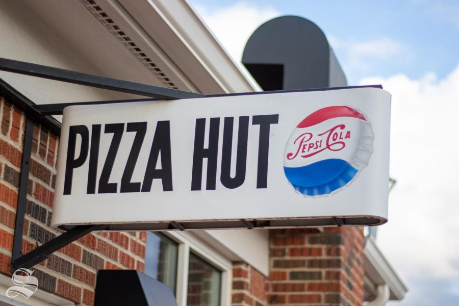 the sing in front of the Pizza Hut Museum. It is one of the classic signs.