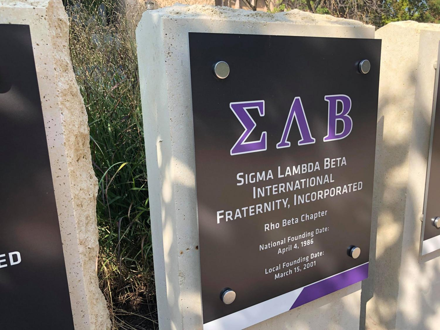 Sigma Lambda Beta's stone is located at the Multicultural Greek Council Quad in front of Clinton Hall. The fraternity said Monday it's filing a bias report after an incident over the weekend.