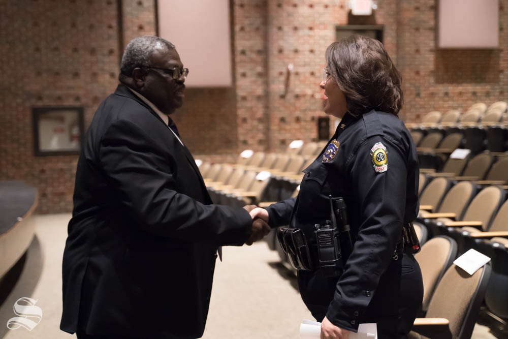 Director of Military and Veteran Services, Lt. Col. Larry Burks, greets Wichita Police Department Deputy Chief Anna Hatter before the  9 /11 Memorial Observance. Wichita State hosted the event at the CAC Theater.