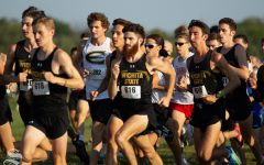 Wichita State junior Alex Moen charges forward with other Wichita State cross country members on Sept. 7 at 4 Mile Creek Resort.