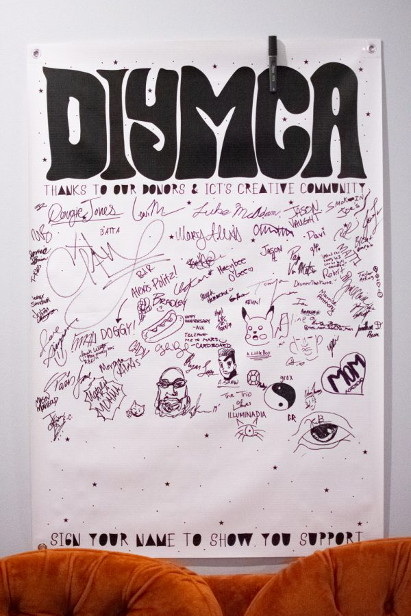 The south interior wall of the DIYMCA venue holds a signable support banner. DIYMCA is an all-ages, inclusive environment which holds support and acceptance highly.