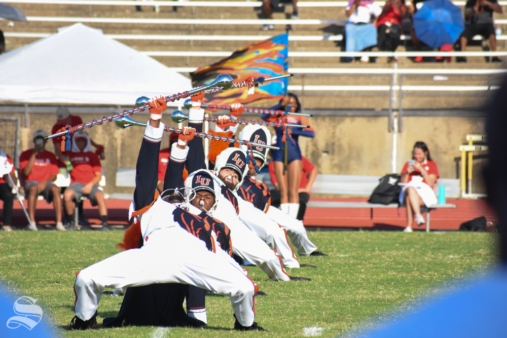 Langston University's marching band section leaders lean in formation during their halftime performance on Sept. 7.