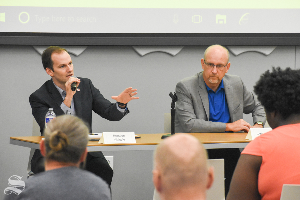 Kansas Rep. Brandon Whipple, left, and Mayor Jeff Longwell answer questions Sunday during a student-led forum for candidates in the Nov. 5 municipal elections. Whipple and Longwell are candidates for mayor of Wichita.