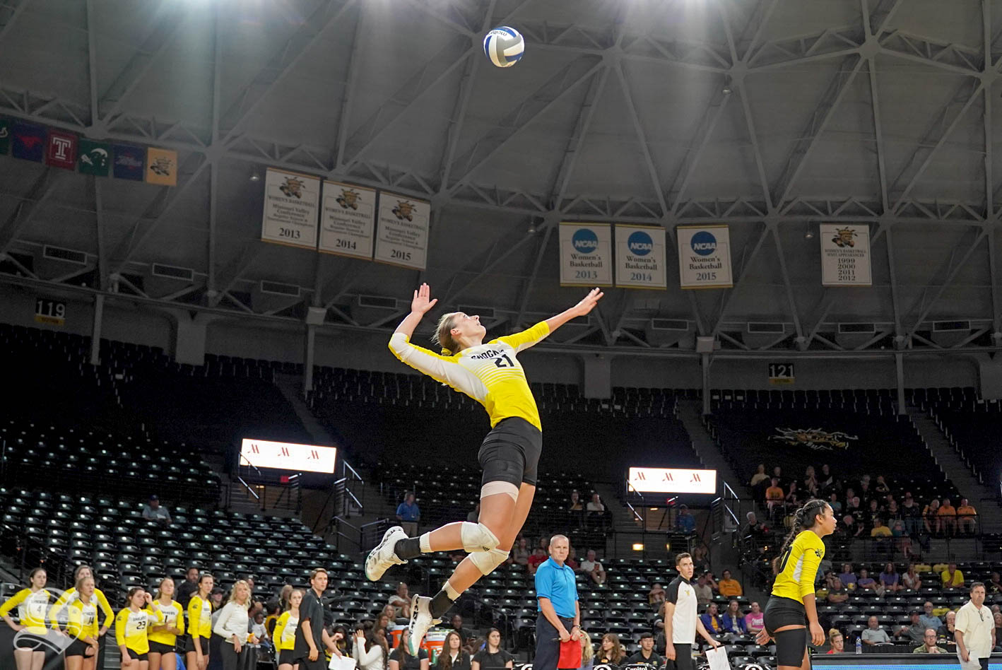 Wichita State sophomore Megan Taflinger goes up for a serve during the Shockers' match against Cincinnati on Sunday inside Charles Koch Arena.