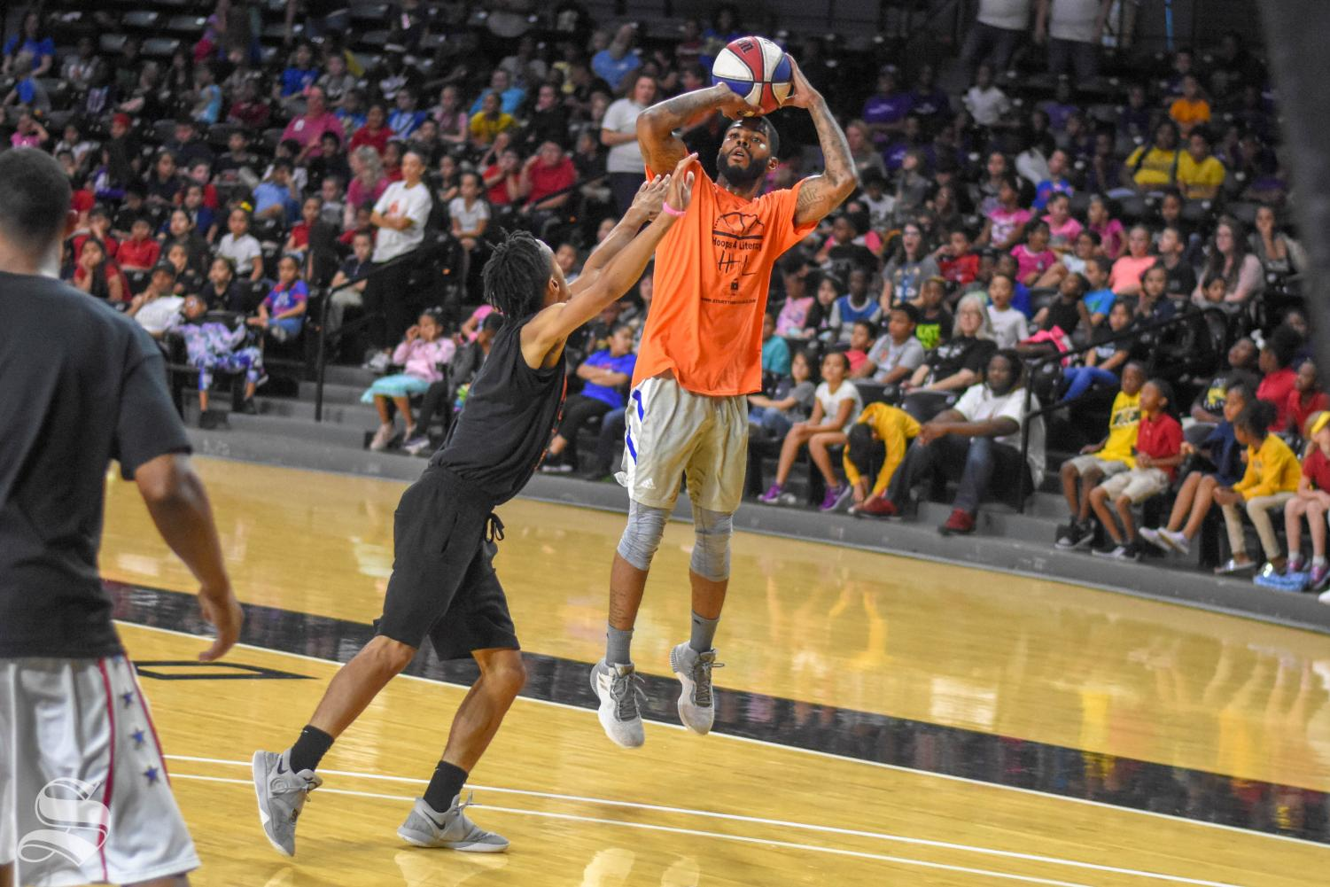 Kaelon Gary goes up for a three-point shot during the Hoops 4 Literacy game that was hosted by StoryTime Village and Wichita State on Friday inside Charles Koch Arena. The event hosted 1,200 local third graders.