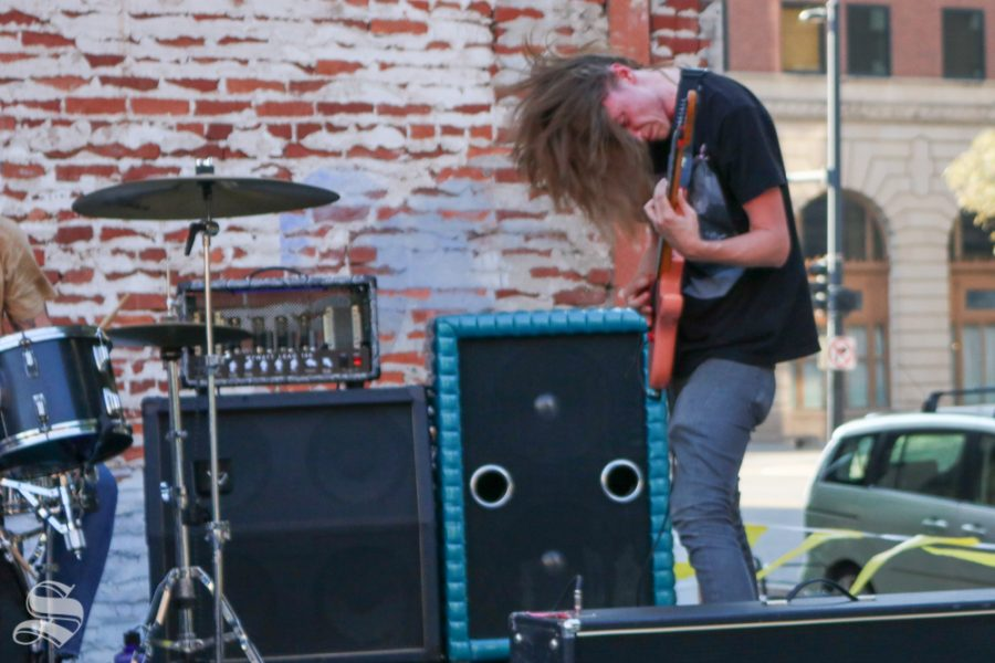 Donovan Ford, guitarist for BHBK, rocks out as he performs at ICT Fest on Friday Sept 6.