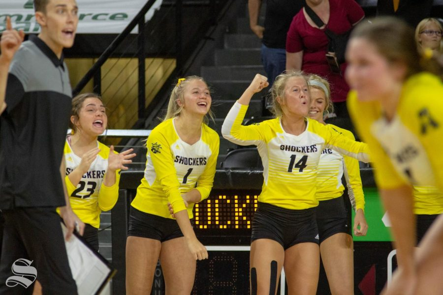 Wichita State freshman Skylar Goering (1) and junior McKayla Wuensch (14) celebrate a point during the Shockers' home opener against BYU.