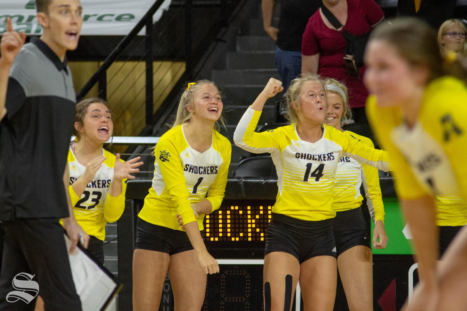 Wichita+State+freshman+Skylar+Goering+%281%29+and+junior+McKayla+Wuensch+%2814%29+celebrate+a+point+during+the+Shockers%27+home+opener+against+BYU.