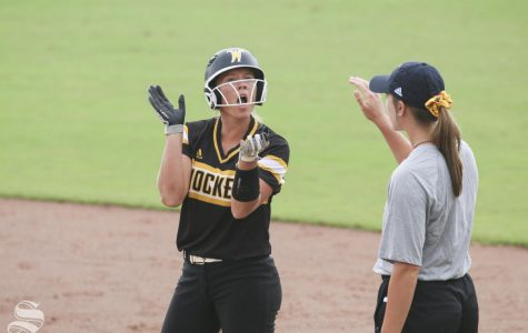 Wichita State's Ryleigh Buck celebrates after getting on base against Central Oklahoma during their scrimmage on Saturday, Sept. 28, 2019.
