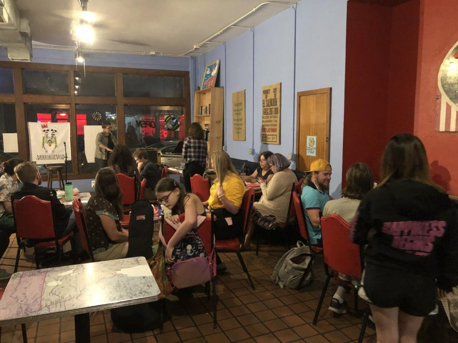 The attendees of Mikrobrew wait patiently in the back of the Donut Whole for the event to begin on Sept. 26.