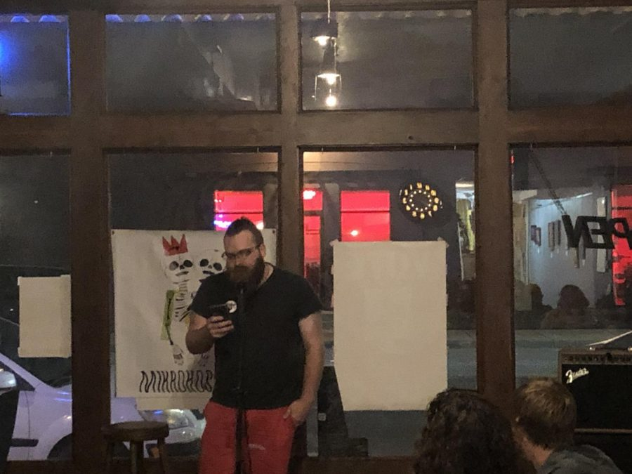 Dan Arndt reads his work to a crowd of friends and strangers during Mikrobrews on Sept. 26 at The Donut Whole.