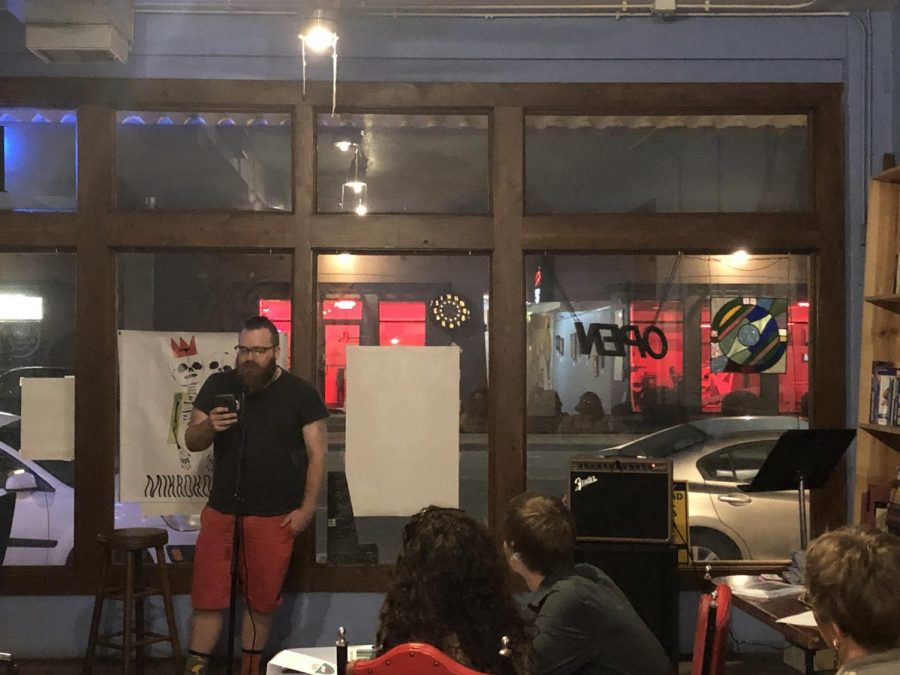 Dan Art reads his work to a crowd of friends and strangers during Mikrobrew on Sept. 26 at The Donut Whole.