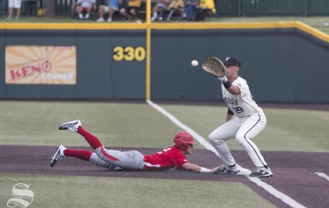 Wichita State's Garrett Kocis attempts to pick off a Nebraska player during the scrimmage held at Eck Stadium on Saturday, Sept. 21, 2019.
