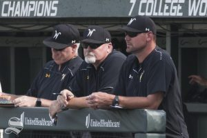 Members of the Wichita State coaching staff stand in the dugout Saturday.