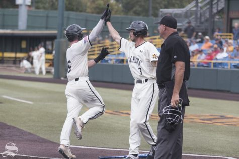 Wichita State's Jack Sigrist and Cooper Elliot celebrate after scoring runs against Nebraska during the scrimmage held at Eck Stadium on Saturday, Sept. 21, 2019.