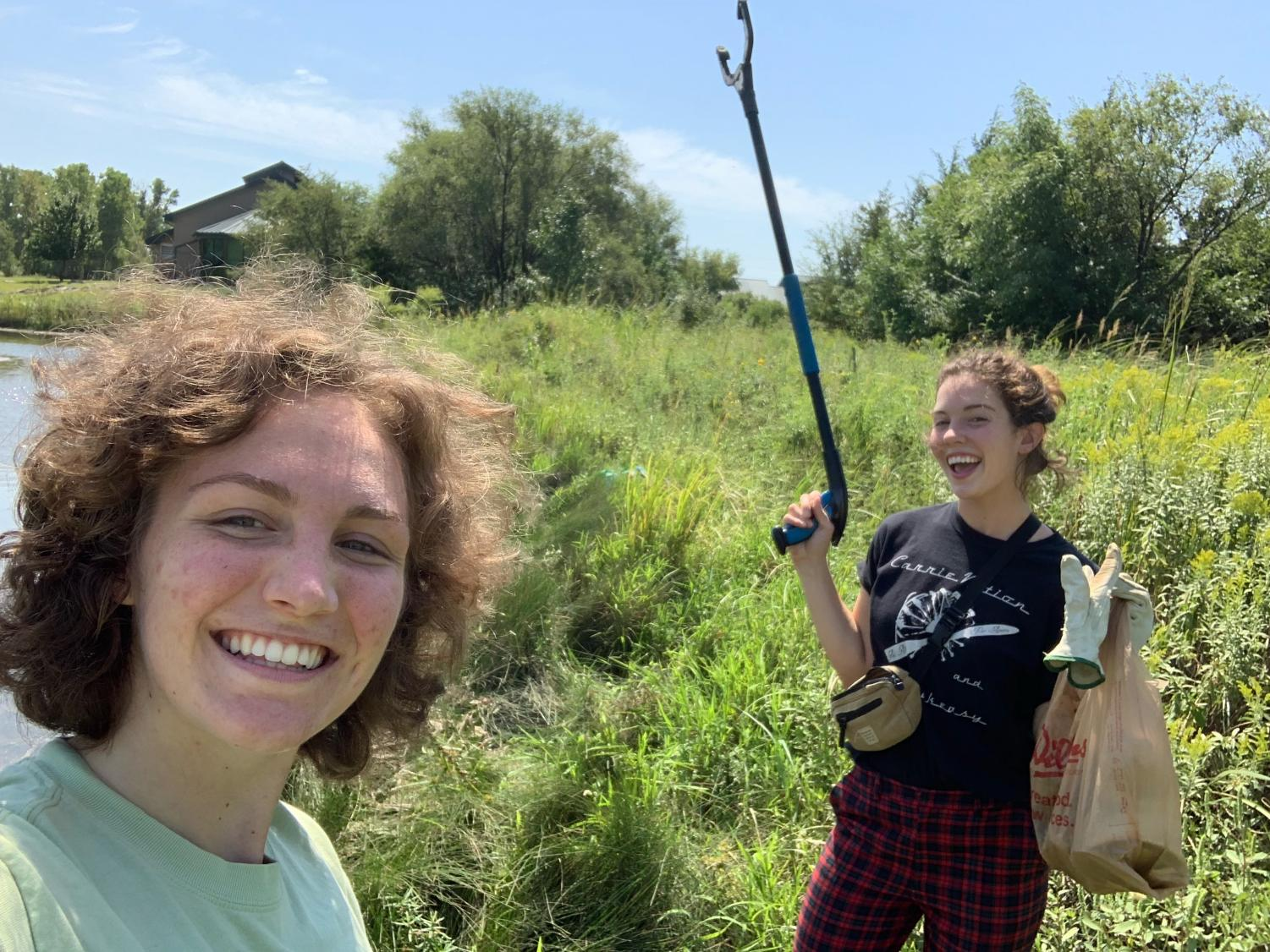 On Saturday, Sept. 7, Madi Laughlin and Morgan Cusick of Green Group cleaned up trash at Great Plains Nature Center.