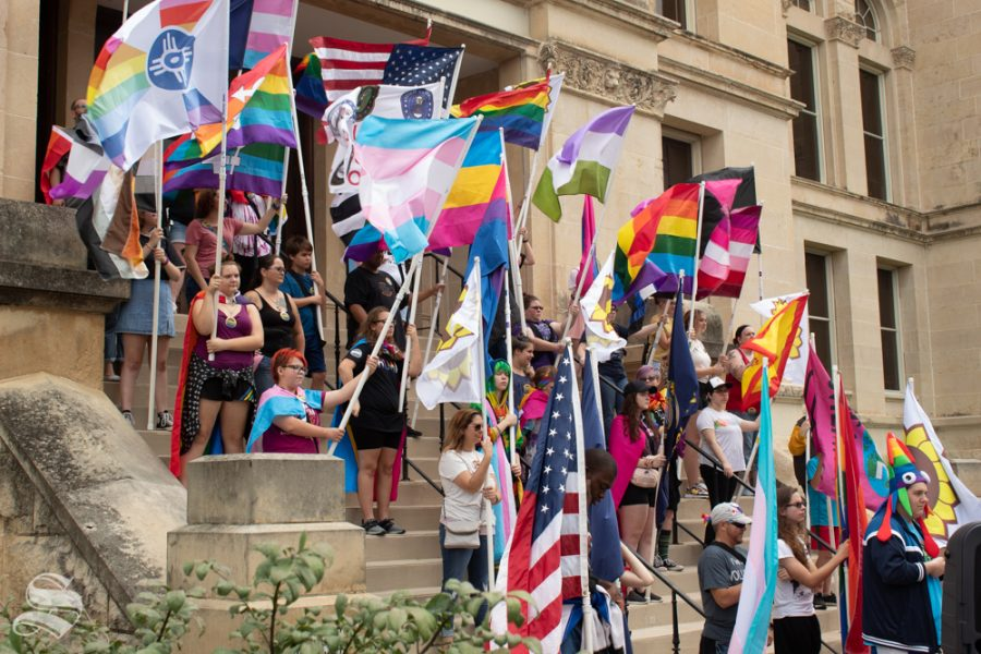 Students+holding+flags+lined+the+steps+of+the+Sedgwick+County+Historic+Courthouse+as+part+of+the+2019+Wichita+Pride+Parade.+GLSEN%2C+an+organization+that+advocates+for+LGBT%2B+student+rights%2C+was+a+sponsor+for+the+event.