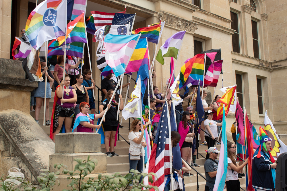 Students holding flags lined the steps of the Sedgwick County Historic Courthouse as part of the 2019 Wichita Pride Parade. GLSEN, an organization that advocates for LGBT+ student rights, was a sponsor for the event.