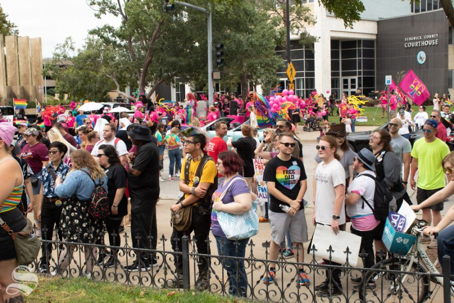 Ralliers gather outside the Sedgwick County Historic Courthouse at the 2019 Wichita Pride Parade. The crowd heard from a lineup of speakers that included politicians, activists and citizens.