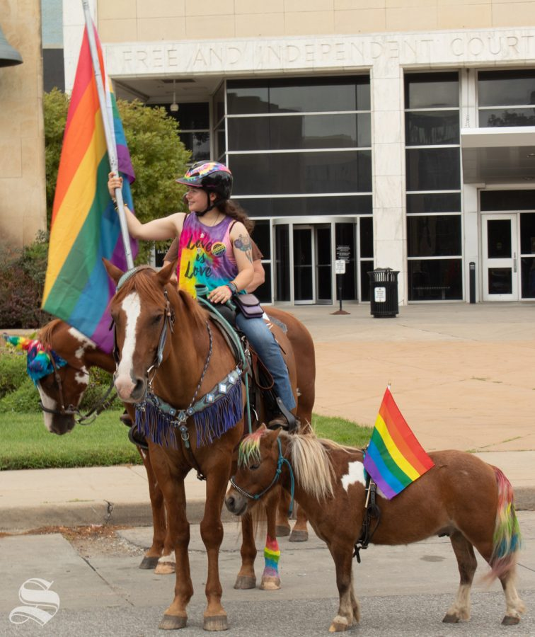 Catherine Sutterfield decked out her horse and miniature pony for the 2019 Wichita Pride Parade. The full-sized horse is Hoss; the miniature one is Texas.