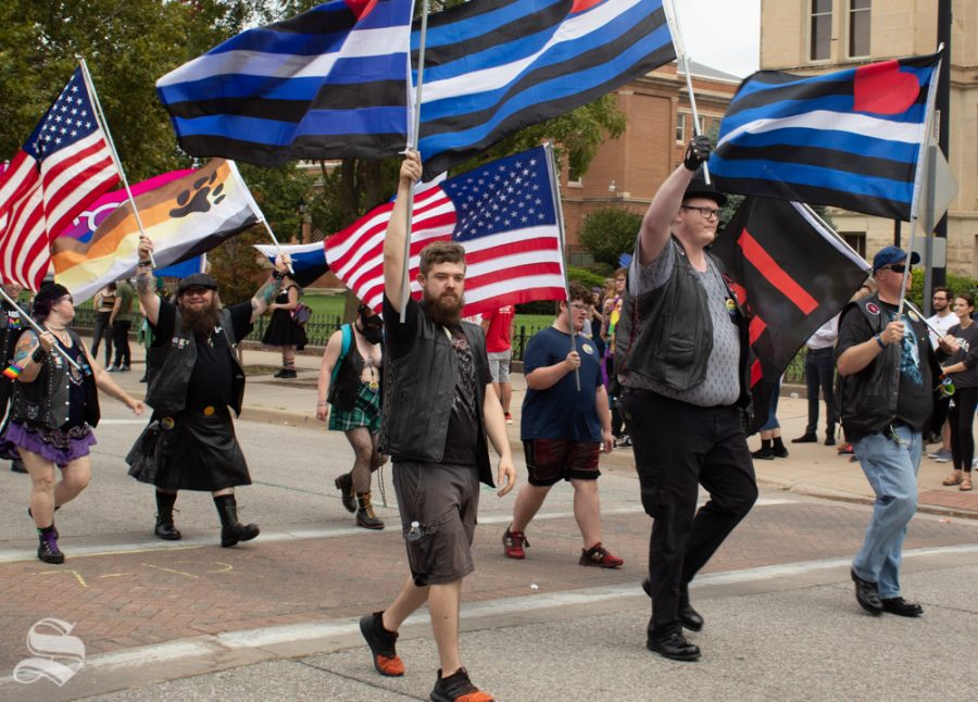 Paraders carry a variety of flags through the 2019 Wichita Pride Parade. Some paraders rode on floats, while others took the one-mile trip on foot.
