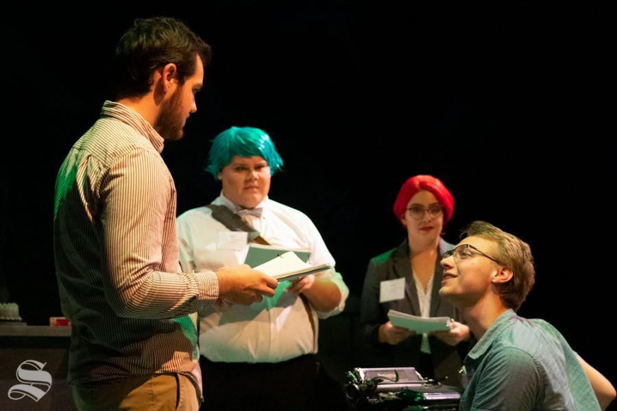 Trevor Seyl (Parker) stands beside Ciaran Schaedtler (Jesse) who thanks Seyls character for giving him a typewriter during a rehearsal of Love Me or Leave Me on Sept. 16 at Welsbacher Theatre. Julian Cornejo (Paul) and Ariel Glorsky (Nancy) watch the couple as the memory unfolds in the play.