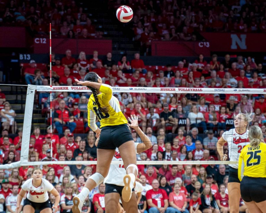Wichita Sate freshman Sina Uluave goes up for a kill against No. 1 Nebraska on Saturday in Lincoln, Nebraska.