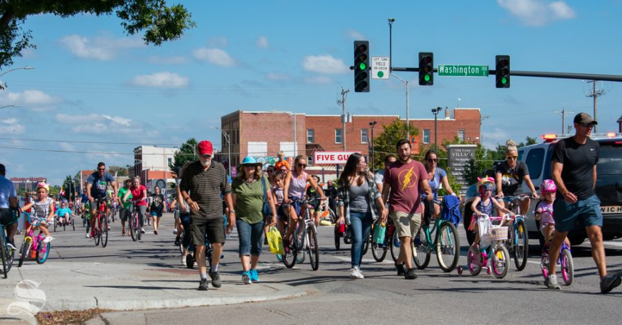 Event-goers+cross+Washington+street+as+they+move+west+down+Douglas+during+Open+Streets+ICT+on+Sept.+22+in+downtown+Wichita.