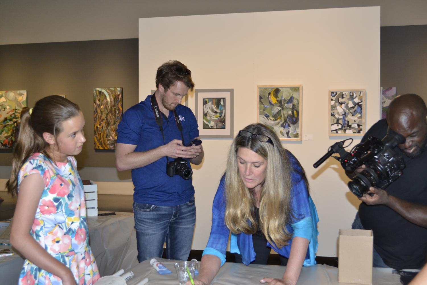 Wichitans Sophie Santo and Susie Santo participate in the public art event hosted by CityArts on Friday Aug. 23 as part of the cross-country #AmericART2019 documentary.