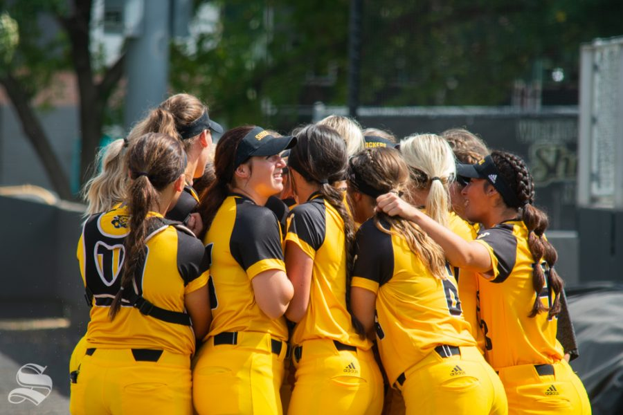 Wichita State team members huddle before their game against Southern Nazarene on Sept. 21 at Wilkins Stadium. The Shockers won their fall opener, 18-3, against the Crimson Storm.