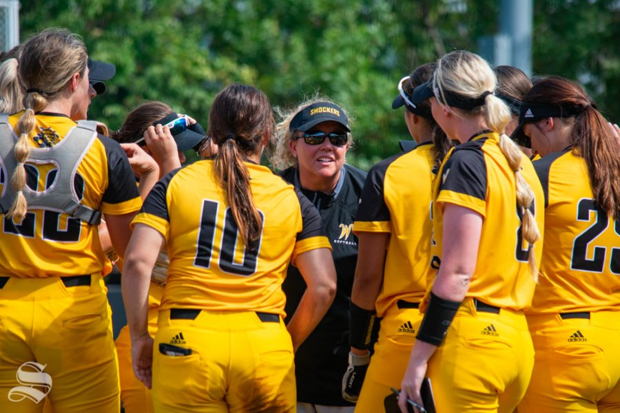 Wichita State head coach Kristi Bredbenner talks strategy with team members during their game against Southern Nazarene on Sept. 21 at Wilkins Stadium.