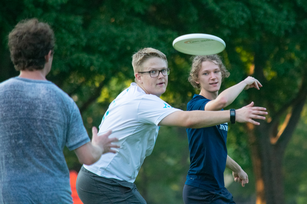 Captain John Mercer looks for the disk that captain David Jochems passes through his guard to a teammate during a Wichita State University Ultimate Frisbee Club practice on Sept. 3 at Fairmount Park. This practice was the first of the year for the club.