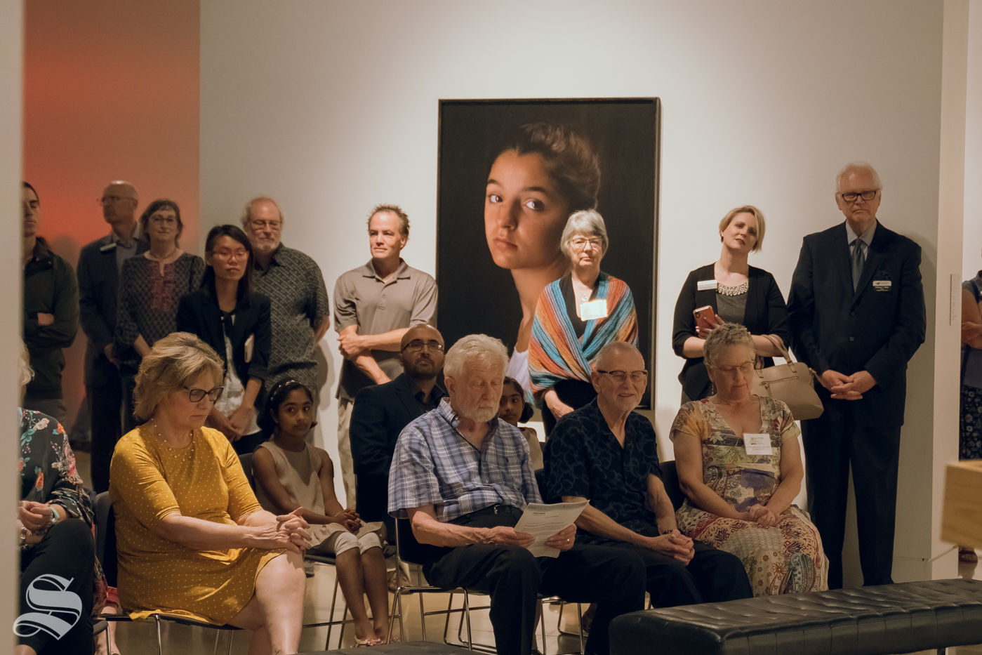 Guests+gather+around+during+the+art+exhibition+opening.+The+event+was+hosted+by+the+Ulrich+Museum+of+Art+on+September+12%2C+2019.