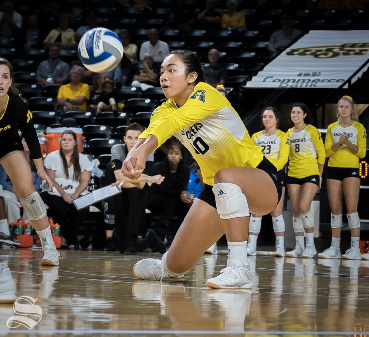 Wichita State freshman Sina Uluave digs a ball during the game against BYU on September 12, 2019 at Koch Arena.