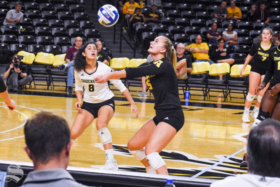 Freshman+Kayce+Litzau+goes+back+to+pass+a+ball+during+the+final+set+of+the+game+against+VCU.